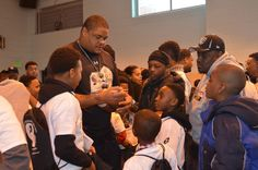 NFL players with youth at Chick Webb Recreation Center during outreach event with the Ed Block Courage Award Foundation
