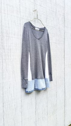 This one-of-a-kind upcycled gray tunic is perfect for work or playing in the city! Made from an up-cycled knit bodice and denim for the bottom and pieced it together in a funky kind of way that is very flattering to the body. Pair with leggings and boots!  *shows a similar dress on a model  SIZE - Small - Medium Chest - 16 across front lying flat - does stretch Hips - 18 across front lying flat - does stretch Length - around 30 - i can adjust length - just let me know at checkout!  Original…