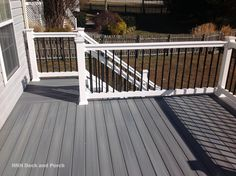 Composite deck using @fiberondecking  castle grey decking with white PVC railing and black square aluminum balusters.