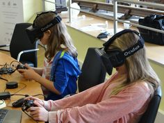 A couple of kids enjoying exploring worlds in virtual reality.