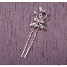 Our Price: $4.98  This elegant starburst rhinestone hairpin is the perfect bridal wedding accessory for the bride-to-be.  Accented in sparkly rhinestones, it shines pretty bright in the light.  Hairpin portion of this wedding hair accessory is silver.
