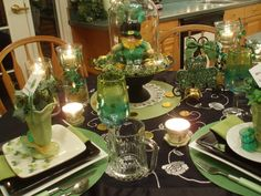 Dining Delight: Embracing the Green. Very clever to put the stuffed leprechaun under a large clouche on a cake stand. Maybe I'll do this with my leprechaun kindles, cupcake stands and clouches.