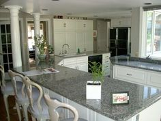 Caledonia granite with white cabinets and stainless steal appliances going into our new house...yay