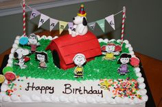 - snoopy birthday cake, with hand painted figurine.. tfl    http://www.facebook.com/cakesdreamer?ref=hl