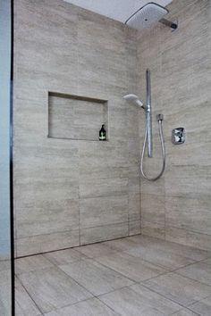 Travertine curbless shower | Splish Splash Shower Systems - our hidden curbless drain