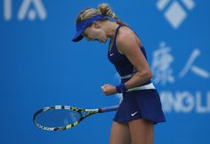 Eugenie Bouchard Photos: Dongfeng Motor Wuhan Open: Day 5. Eugenie Bouchard of Canada reacts during her match against Alize Cornet of France on day five of 2014 Dongfeng Motor Wuhan Open at Optics Valley International Tennis Center on September 25, 2014 in Wuhan, China.