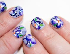 DIY Flower Nail Polish Decals: pretty purple violet manicure with lilac creme base and sapphire shimmer