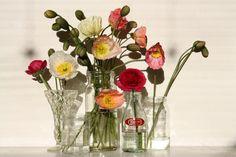 #Design Tip:  mismatched glassware & single stem florals grouped together make an inexpensive centerpiece!
