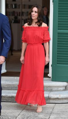 Lady in red: The glamorous royal, who has been dazzling in a series of bespoke frocks this week, opted for a bargain - down from £2,075 to£1,453