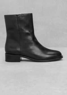 Crafted from calf leather, these boots feature a comfy ankle height, a zip-closure, and an all over smooth texture.