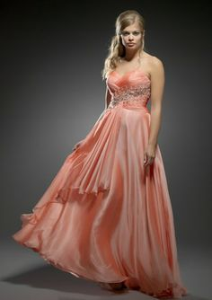 In coral, this silky chiffon gown has yards of fabric for a true flowing look - from Exquisite by Scarlett Evenings.