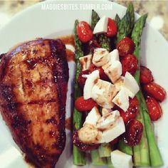 Ill have to try this!!  Balsamic Chicken, Asparagus and Roasted tomatoes with Mozzarella ... only 335 calories!