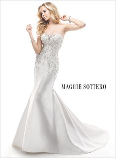 Swarovski crystal beaded wedding dress with strapless neckline... Charlie by Maggie Sottero. Gorgeous!