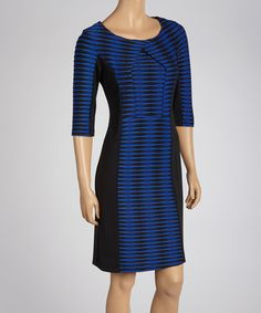 Perfect for desk-to-dinner days, this dress combines contemporary style with a classic fit. Abstract stripes style the center panels, while a crossover detail at the neckline adds to its modern appeal. Measurements (size 6): 37'' long from high point of shoulder to hemSelf: 96% polyester / 4% spandex            Contrast: 72% polyester / 24% rayon / 4% spandexMachine wash; hang dryImported