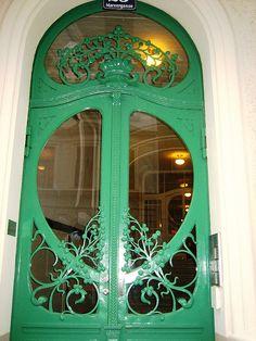 Green Art Nouveau door. Vienna, Austria