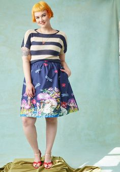 <p>Incorporate your interest in all things mythical into your edgy fashion ingenuity by experimenting with styling this navy skirt - part of our ModCloth namesake label! Fluttering dragonflies, purple mushrooms, and chill toads intermingle with vibrant flora, uniquely decorating the broad waistband, flattering gathering, and pocketed silhouette of this woven cotton bottom.</p>
