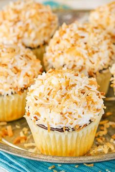 Coconut Macaroon Cupcakes! Full of coconut flavor with a coconut meringue frosting!