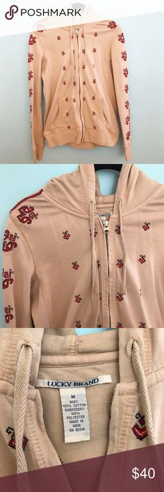 Lucky Brand Tan Embroidered Hoodie A classic tan Lucky Brand hoodie with red embroidered detailing. Size medium in great condition! Lucky Brand Tops Sweatshirts & Hoodies
