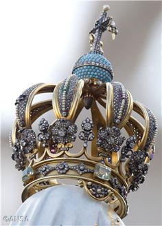 This is the crown from the Our Lady of Fatima statue used in last weekend's Consecration and which now sits at the residence of Pope Emeritus Benedict.  The object coming down from the center is the bullet that lodged in Pope John Paul II after a failed assassination attempt in 1982. He always credited Our Lady with his survival.