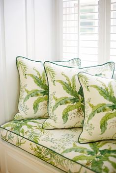 Window seat and throw pillows in a botanical print with contrast piping in dark green. (Suellen Gregory)