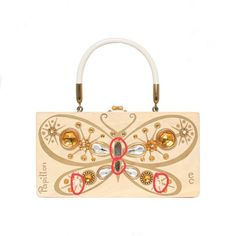 """Enid Collins of Texas """"Papillon"""" box bag.  Papillon is the French word for butterfly. This papillon is missing four jewels, and I have yet to see a similar purse to help solve the puzzle! #findingENIDwithLOVE #enidcollinsoftexas #enidcollins #papillon #butterfly #flutterbye #1960s #vintagebag #vintagestyle #vintagepurse #art #anthropology"""