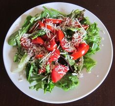 Green salad with lettuce, tomato and Parmesan cheese