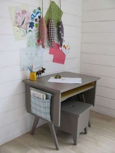 This little grey desk has a rustic look but it can also look beautiful in a more modern setting. It has a shelf for storage and a side pocket and the seat appears to include some hidden storage as well.