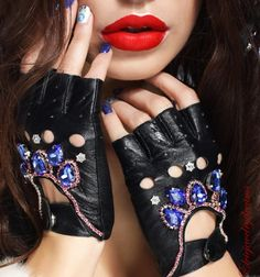 Driver gloves are always a hit. Add a touch of glamorous fantasy to your driving look. The fingerless style is cut from the finest black leather and embellished with sparkling crystals and sequins. Edgy and fingerless, they're guaranteed to amp up your look to new season perfection. ♥ Want to save for later? Click on the heart button that says Favorite. ♥ Ready to buy? Click the big green Add to cart button. ♥ Questions about how to buy? http://www.etsy.com/help/article&#...