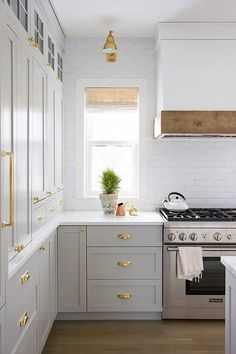 Gorgeous renovated kitchen with organic accents and beautiful decor. Gorgeous renovated kitchen with organic accents and beautiful decor. Love the white brick, golden sconce, shades, and gray cabinets. Rustic Kitchen, New Kitchen, Kitchen Decor, Kitchen White, Kitchen Ideas, Awesome Kitchen, Country Kitchen, Kitchen With Brick, Kitchen Windows
