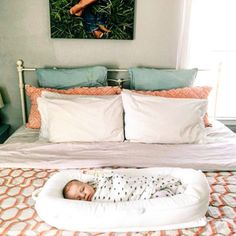 DockATot is the perfect portable baby bed for afternoon snoozes on mom and dad's bed. This chic multifunctional baby lounger / baby bed is a must have for new moms.