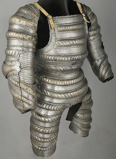 Three-quarter armour, South Germany c. 1520 - 1525, medium-carbon steel, hardened and tempered through heat-treatments, in some parts a full-quench, in others an accelerated cooling, gold and copper alloy, embossed, pierced, etched, cross-hatched and gilt, possibly once blued, 12.19 kg, total weight, Wallace Collection, A28.