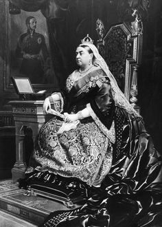 An 1883 painting of Queen Victoria (1819 - 1901), taken from an 1882 photograph by Alexander Bassano. Behind the queen is a portrait of her deceased consort, Prince Albert, by German artist Franz Xaver Winterhalter, and the box beside her is labelled 'First Lord of the Treasury.'