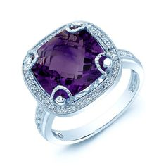 Command attention with this gorgeous gemstone ring. This flashy cocktail ring has a large purple amethyst stone, which is held in place by four decorative prongs. Surrounding the stone are a bevy of d