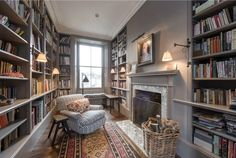 Home Library with a cosy fireplace and reading chair