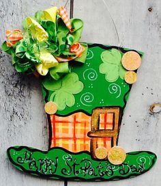 This fun decorative Leprechaun door hanger is the perfect accent for any room or door to celebrate St. Patrick's day   The designs are a combo of plaid,  polka dots,and my signature swirls. Colors are a combo of greens and yellows which is painted with ...