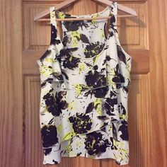 REDUCED! Old Navy Razorback Tank [Sz M] Old Navy Razorback Tank/Blouse. Adorable tank to wear as is or with a suit for work! Three layers of ruffles on the front. Golden flowers with very dark chocolate accents. So dark it works with brown OR black. Worn only once. Seems to be one of Old Navy's higher quality pieces. Size Medium. Pet free, smoke free home! Old Navy Tops Blouses