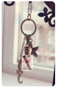 Message in a Bottle necklace. Glass bottle pendant with starfish and seahorse. miniature bottle vial pendant Ocean necklace cute. €9.99, via Etsy.