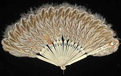 Vintage Fan: 19th Century French by CharmaineZoe, via Flickr          Punched Paper and Feather Fan with Mirror 1863.       The fan's mirror made it possible for its owner to see discretely who was behind her.