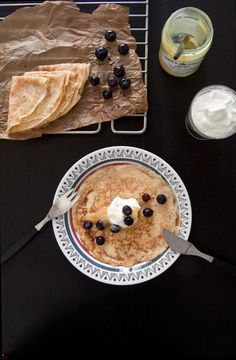 Swedish pancakes with blueberries, lemon curd and whipped creme fraiche.
