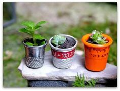 """Paint bottle caps black. Dot them with dark grey. End result = tire pot. Fill with """"dirt"""". Insert """"plant""""."""