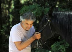 Andrea Bocelli with horses