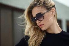 Gold nose , dark sunglasse