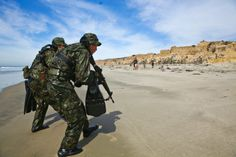 Japan Ground Self-Defense Force soldiers secure a beach while conducting an amphibious raid during Exercise Iron Fist 2014 aboard Camp Pendleton, Calif., Feb. 15, 2014. RICARDO HURTADO/U.S. MARINE CORPS