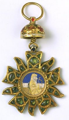 This order of merit, made in Lahore around 1879, is of enamelled gold set with emeralds.This award was introduced by Ranjit Singh, possibly in direct emulation of the French Legion d'Honneur worn by one of his foreign military commanders, General Allard. It may be the 'Star of prosperity of the Punjab' instituted in 1837 on the occasion of the wedding of his grandson and came from the collection of his son Duleep Singh.