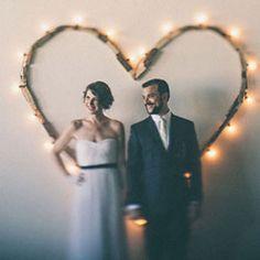 A warehouse wedding with a fabulous homemade heart backdrop!