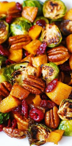 Roasted Brussels Sprouts, Cinnamon Butternut Squash, Pecans, and Cranberries (and maple syrup). YUM! Side dish recipe.