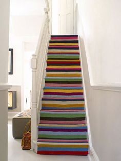 "Love these images from Poppytalk 's ""if I had a house"" post, particularly the stripes up the stairs."