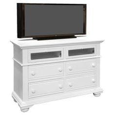 """Showcasing a white finish and turned bun feet, this lovely media console brims with classic country style. Its 4 drawers and 2 glass doors offer ample storage for electronics and accessories, making it the perfect addition. Dimensions: 37"""" H x 52"""" W x 19"""" D Dimensions."""