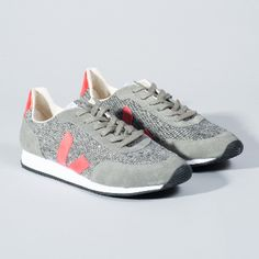 Veja  Grey Flannel Arcade Trainers: Made from low chrome leather and organic cotton, these trainers are a must have for any style hunter with concern for the environment. Contrast textured panels, classic brand 'V' in contrast red on the sides (made from wild rubber), durable and lightweight rubber sole, modern and eco-friendly.