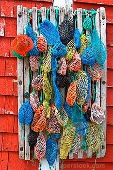 fishnets hanging on wooden rack.    .........beach